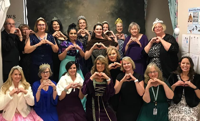 BLS staff dress in fancy clothes, crowns and tiaras, and make hearts with their hands.